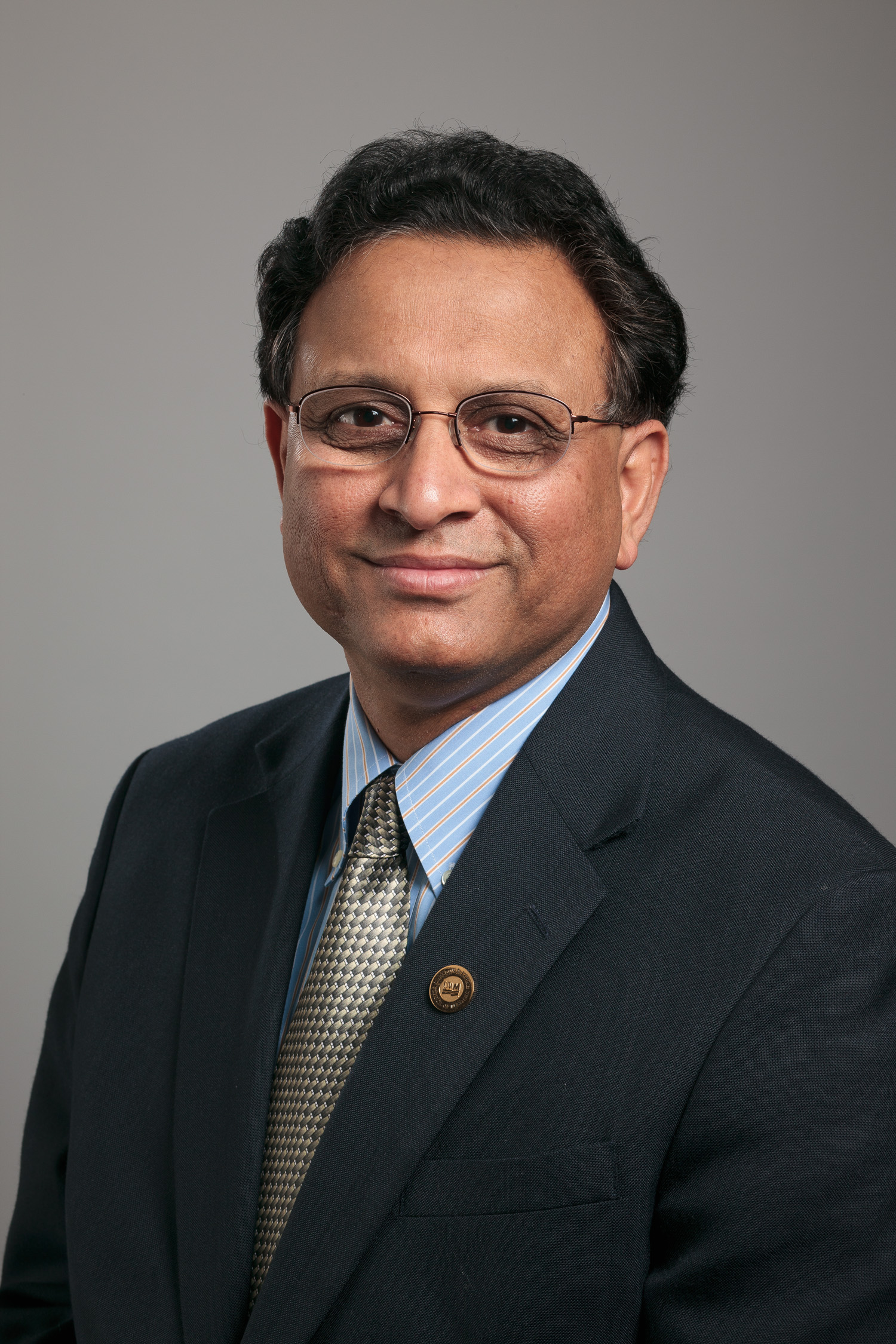 Studio portrait of Atish Sinha of the Lubar School of Business.